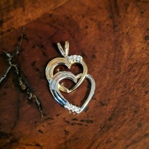 Jewelry - Silver and gold heart pendent.